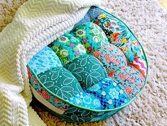 Craft Gossip - http://sewing.craftgossip.com/tutorial-tufted-round-patchwork-floor-cushion/2015/03/10/