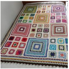 I want to make this!  Somehow it makes stodgy, old Granny squares look so great!  