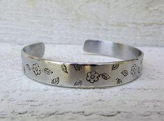 Hand stamped silver aluminum cuff bracelet flowers by Amayeli, $19.00