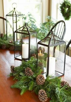 Surround lanterns with fresh greenery and pine cones for a classic, elegant centerpiece. Click for more centerpiece ideas!