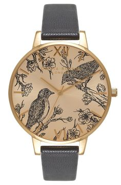 So cute! Ornithological illustrations enliven the dial of this whimsical round watch accented with a highly polished case and a lightly textured leather strap.