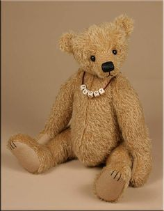 'Noah' a traditional teddy bear created by Paula Carter....love the name in blocks....he'd be cute with a necktie too! csb