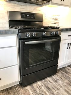 City House Kitchen – The Marshall Remodel Kitchen Cabinets With Black Appliances, Country Kitchen Cabinets, Farmhouse Kitchen Decor, Kitchen Redo, Kitchen Styling, Kitchen Remodel, Kitchen Ideas, Kitchen Room Design, Kitchen Designs