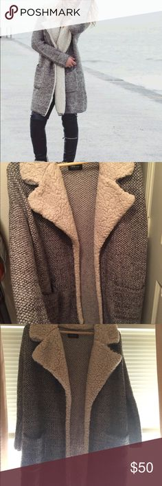 Zara grey wooly knit lightweight coat worn abt 5x This is a cozy grey sort of marled lightweight winter coat from Zara. I got it a couple winters a go and have only worn it about 5 times. It is a s and I am more of an xs. It could fit an xs or s with an oversized or slightly oversized fit and I think it could easily fit a medium snugly. I am unsure of the material but it feels like a lightweight wool blend. It is warm enough with layers for cold weather. It looks basically new and the collar…