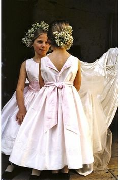 Isabel Garretón Fantasy Silk Ivory Dress: An elegant girls silk dress with an abundance of beautiful, hand embroidered details and pearls looping the neckline and distinctive folding back opening. In stock and ready to ship Cotillion Dresses, Ivory Dresses, Little Girl Dresses, Girls Dresses, Vintage Flower Girl Dresses, Flower Girl Outfits, Rustic Flower Girls, Elegant Girl, Communion Dresses