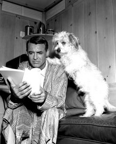 Cary Grant with his dog reading a script