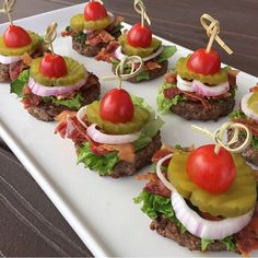 Stack Sliders • All you football lovers, these are for you! We both have husband/kids that love watching football and so it's always fun having yummy game day food! We took a mini hamburger patty stacked lettuce, bacon, purple onion, pickle slice, and 1/2 a cherry tomato on top. Their almost too cute to eat….almost!