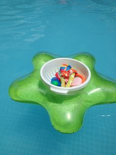 1.00 strainer + 1.00 floatie = perfect holder for all those little toys for the pool!