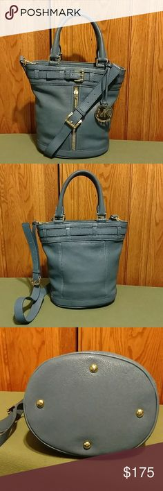 """Michael Kors Kingsbury Bag -Medium Beautiful blue handbag with additional crossbody strap. Excellent condition, no stains or marks. One issue with the bag charm strap as seen in pic.(Reflected in the price). Vertical zip pocket exterior front. Slip pocket exterior back.   11.5"""" wide x 10"""" high x 6.5"""" deep. Handle drop is 5"""", shoulder strap drop 20"""" at its shortest. Gold hardware. Leather. Dust bag included. Michael Kors Bags"""