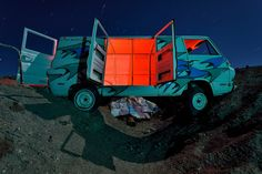 derelict dodge A-100 van bridging the gap at the international car forest of the last church. the car forest is a fascinating art project consisting of about 40 cars and buses planted into the dirt of the central nevada desert. nikon D7000 + nikkor 10-24mm. 120 second exposure, light painting with LED flashlight, cyan & red gels. 3x 2min stacked exposures for star trails. https://www.picturedashboard.com