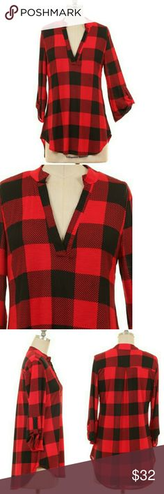 COMING SOON Red Plaid Roll Sleeve Blouse A gorgeous v-neck blouse with cute button roll sleeves...LOVE! Wear this with a great pair of jeans and tall boots.   92% Polyester, 8% Spandex.  Made in the USA.  Fits true: Small 2/4, Medium 6/8, Large 10/12 Tops Tunics