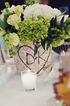 cute centerpieces with tree stumps and initial carvings
