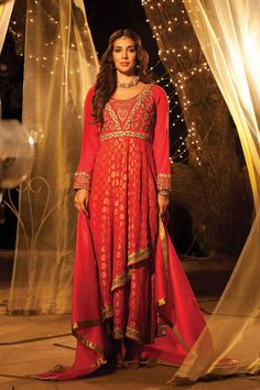 Stun the regular wedding crowd with a look that's contemporary yet age old royal. A silk brocade anarkali with an edgy twist of a double-layered ghera is teamed up with a matching plain chanderi dupatta. The embroidered yoke adds that exquisite touch to an already sensational outfit.