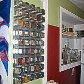 Magnetic Spice Rack. Looks awesome in my kitchen! The various spice colors make an amazing art piece in itself...if you love to cook and hate buying duplicates of spices over and over again, highly suggest investing in magnetic spice tins. EXTREMELY WORTH IT!