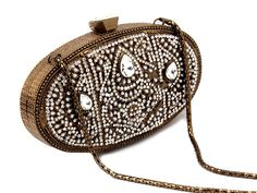 Glowing brown color brass metal clutch #Purse ornamented with glittering diamantes, pearls and crystals. Item Code: SJBP2018 http://www.bharatplaza.com/new-arrivals/accessories.html