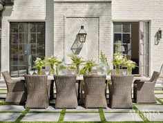 Just off the family room is a handsome outdoor dining area atop a patio of bluestone pavers. Featuring a custom concrete table by Kleinhelter and Kingsley-Bate's Sag Harbor seating, the setup is framed by striking steel doors and a brick accent wal Outdoor Living Areas, Outdoor Rooms, Outdoor Furniture Sets, Furniture Ideas, Wicker Furniture, Modern Furniture, Outdoor Patios, Business Furniture, Outdoor Kitchens