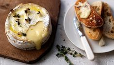 One camembert cheese, pierced and packed with garlic and thyme, 20 minutes in the oven