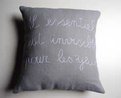 "Light grey/blue linen fabric pillow case hand-embroidered with the french quote ""L'essentiel est invisible pour les yeux"" (what is essential is invisible to the eyes).Envelope closure on the back.Measures 16""x16"" (40x40 cm).Pillow insert not included."