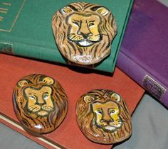 Lions painted rocks