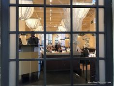 A front window looking into Gotham Bar and Grill #Seekender
