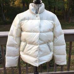 Coach Down Cream Puffer Jacket Leather Trim Size S Coach Down and Feather filled Cream Colored Puffer Jacket. Leather Trim and Collar. Size Small. Snap close and toggle close top. 2 zip close pocket. Shiny and clean-small pink spot on right sleeve, otherwise clean. No trades Coach Jackets & Coats Puffers