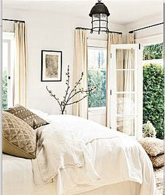 Soft relaxing bedroom in creamy off white amp tan with accents in black