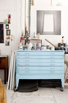 vintage paper drawer painted powder blue. shallow drawers would be perfect for storing jewelry/craft supplies.
