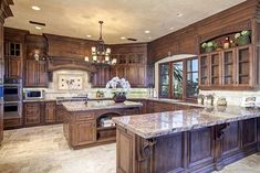 """""""View this Great Traditional Kitchen with Complex granite counters & Custom hood in San Diego, CA. The home was built in 2007 and is 10750 square feet. Discover & browse thousands of other home design ideas on Zillow Digs. Dark Wood Kitchens, Rustic Kitchen Cabinets, Rustic Kitchen Design, Best Kitchen Designs, Farmhouse Style Kitchen, Modern Farmhouse Kitchens, Home Decor Kitchen, Interior Design Kitchen, Cool Kitchens"""