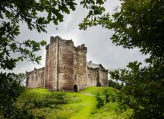 Doune Castle Doune, United Kingdom tree outdoor building castle sky Ruins château medieval architecture grass national trust for places of historic interest or natural beauty fortification historic site stone old history stately home archaeological site landscape abbey surrounded lush