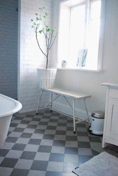 love the grey and white tile floor