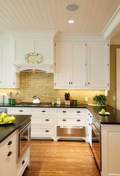 like cabinets, stove hood, tiles, molding seems to camoflage uneven ceiling.  Hood Cabinet