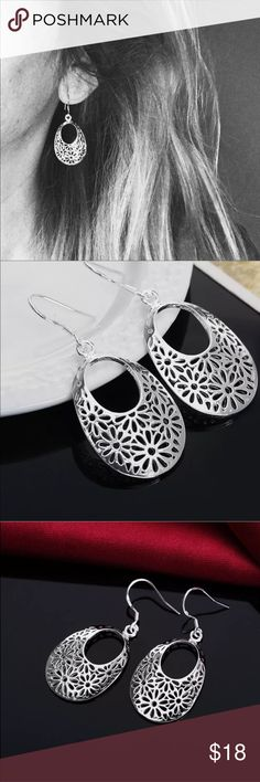 "NWOT Silver Filigree Daisy Flower Drop Earrings New without tags wired earrings have Filigree cut out design of Daisies. For pierced ears only.  Sterling silver plated.  Approx total length 1.75"", width 0.75"". Jewelry Earrings"