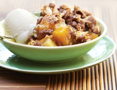 A home-style dessert gets a tropical twist by baking spiced mangoes and pineapple beneath a crunchy crumble topping. Serve with non-dairy, vanilla ice cream.  Ingredients:   ½ cup all-purpose flour  ⅓ cup old-fashioned rolled oats  ¼ cup plus 3 Tbs. packed light brown sugar, divided  1 ¼ tsp. ground cinnamon, divided  ¾ tsp. grated nutmeg, divided  ¼ tsp. ground allspice, divided  ¼ tsp. salt  5 Tbs. chilled vegan margarine, cut into pieces, divided  ½ cup raw pecans, coarsely chopped  And…