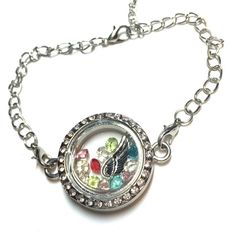 Floating memory locket bracelet Floating memory locket bracelet 10 1/2 inches long adjustable to any size. Comes with the charms shown. Jewelry Bracelets