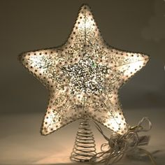 Everything is taken care of with this star tree topper - pre-lit - well made - beautiful - its got it all! Decorating With Christmas Lights, Christmas Decorations, Christmas Tree, Lighted Star Tree Topper, Unique Tree Toppers, Iridescent Fabric, Light Well, Light Decorations, Candle Holders