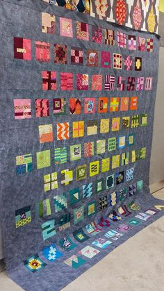 My version of Sliding Scale from Tula Pink's 100 Modern Blocks.  99 squares!