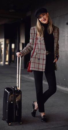 Perfect Travel Outfits // Oversized plaid blazer, black high-waisted pants, black turtleneck, loafers, baker boy black hat, deep red lip { Gucci, Theory, Armani, best travel style, airplane outfits, comfortable travel outfits, fall winter style, fashion blogger }