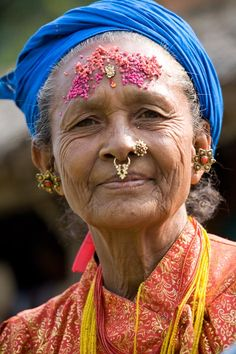 Nepalese woman adorned for ceremony in Nepal.                                                                                                                                                      More