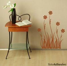 Vinilo decorativo, cuyas formas curvilíneas y con una flor en lo alto, representa unas flores en el prado. La naturaleza en estos tiempos tenemos que cuidarla y disfrutarla y este modelo de vinilo floral podremos llevarla a la pared de nuestro hogar. Apto para todo tipo de espacios. #teleadhesivo #decoracion
