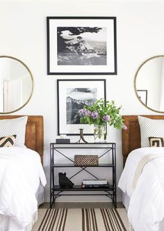 Layered twin bedroom design with round mirrors and console table via Thou Swell @thouswellblog