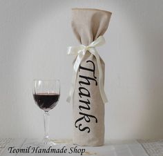 This natural color linen bags perfectly fit wine bottles, olive oil bottles, beer bombers and many other things! Wrapped with an ivory satin ribbon, these