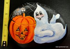 hand painted rocks, halloween decor, ghosts,pumpkins and spiders