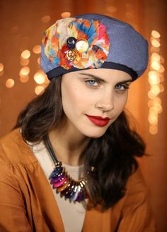 Classy beret made of inside-out jeans material This gorgeous hat is  decorated with an 11bb29e8906e