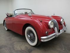 1959 Jaguar XK150 Drophead Coupe – with matching numbers. This car comes in red with black interior and is a nice weekend driver that has had the same owner for over 30 years. It does have some rust in the sills but it is a mechanically sound vehicle. For $59,500