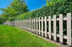 Traditional picket fence design in light brown.