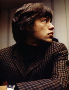 Mick Jagger... I love this photo of Mick, and his jacket. He used to dress pretty well in the mid 60's- then....crash.