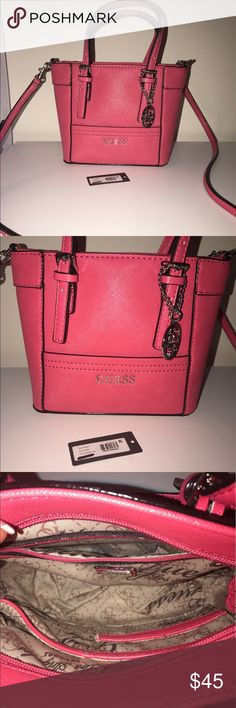 """New without tags Guess Delaney mini pink New without tags Guess Delaney mini satchel Tote purse in pink. Bought from eBay in May 2017 but I really don't need another purse! Top zipper plus removable logo medallion.  Removable shoulder strap with 22.75"""" drop. Dual top handles with 4"""" drop. 9""""W x 6.75""""H x 3.25""""D Guess Bags"""