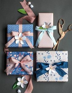 Beautiful way to pack gifts with satin ribbons and flowers