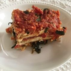 A thick tomato-based sauce is cooked up with hints of garlic, onion, parsley, and basil, and layered with a tofu and spinach filling. Vegetarian Main Dishes, Vegan Vegetarian, Vegetarian Recipes, No Noodle Lasagna, Pasta Noodles, Entrees, Food To Make, Favorite Recipes, Meals