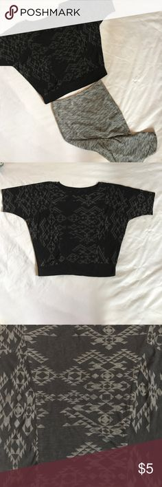 NWOT❗️Geometric black patterned top ▫️Top to bottom is 20 inches.  ▫️Armpit to armpit is 22 inches.  The top is wider on top for a nice loose fit and then tightens at the hips. The top is black with a gray geometric type pattern. The top is from Mambo Australia and in a size S. The shirt was never worn because it's just too big for me. Mambo Tops Tees - Short Sleeve